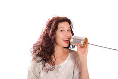 Woman talking with tin phones. Portrait of a cute middle aged woman talking with tin can phones isolated over a white background Stock Images