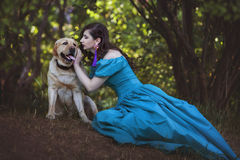 Woman is talking to a big dog. stock photography