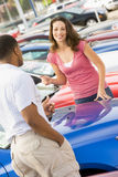 Woman talking to car salesman Stock Images