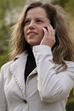 Woman talking to a cell phone Royalty Free Stock Photo