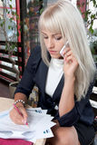 Woman talking to cell phone Royalty Free Stock Photo