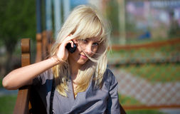 Woman talking to cellphone Stock Image