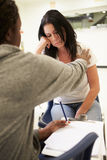 Woman Talking To Counsellor Who Takes Notes Royalty Free Stock Photography