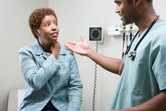 Woman talking to doctor Stock Photos