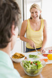 Woman Talking To Husband While Preparing meal Royalty Free Stock Images