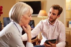 Woman Talking To Male Counsellor Using Digital Tab Royalty Free Stock Photos