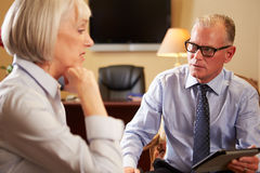 Woman Talking To Male Counsellor Using Digital Tablet Royalty Free Stock Images