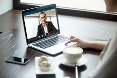 Woman talking to man in headphones via video call. stock images