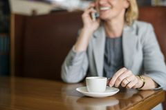 Woman Talking to Phone White Drinking Coffee Stock Image