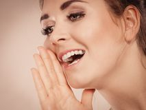 Woman talking gossip with hand close to lips Royalty Free Stock Images