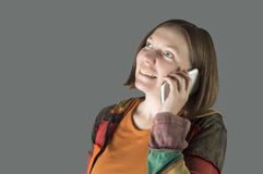 Woman talking to someone on her smart phone. Royalty Free Stock Photo