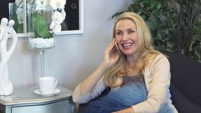 Lovely woman talking on the phone royalty free stock photography
