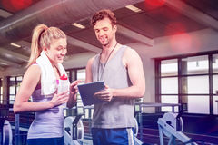 Woman talking to trainer after workout Royalty Free Stock Images