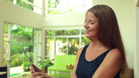 Woman talking using tablet stock footage