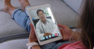 Woman talking on video meeting on her digital tablet