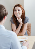 Woman talks with man at the bar Royalty Free Stock Photos