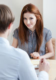 Woman talks with man at the coffee bar Stock Image