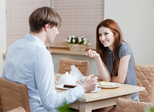Woman talks with man at the coffee house Royalty Free Stock Image