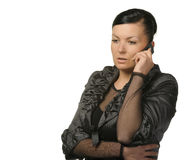 The woman talks by a mobile phone Royalty Free Stock Photography