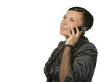The woman talks by a mobile phone Stock Images