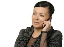 The woman talks by a mobile phone Stock Photography