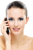 Woman talks by mobile phone Royalty Free Stock Photography