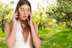 Woman talks on mobile Stock Photos