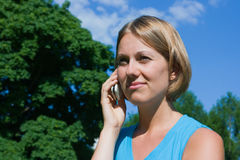 The woman talks by a mobile phone. Woman with a mobile phone Stock Images