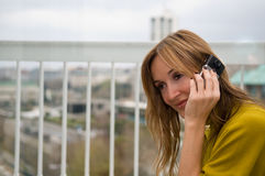 Woman talks on the phone Stock Image