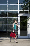Woman Talks on Phone While Walking - Vertical Stock Photos