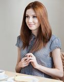 Woman talks with someone at the cafe Royalty Free Stock Photography