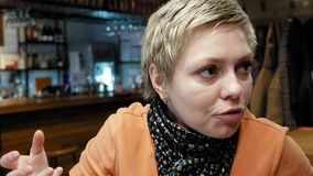 Woman talks to friend with emotions and expression Stock Photography