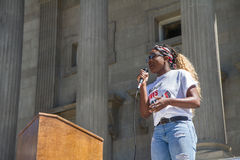 Woman talks to those gathered. BOISE, IDAHO-JULY 16 2016: Woman speaks to the crowd in front of the capital during a Black Lives Matter rally in Boise Royalty Free Stock Photo