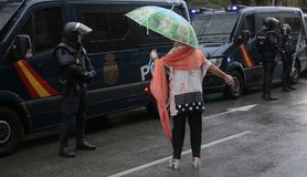 Banned pro independence referendum day in barcelona. A woman talks to Spanish police in full riot gear before charge demonstrators during a protest during the Stock Images