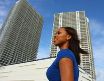 Woman And Tall Buildings Royalty Free Stock Images