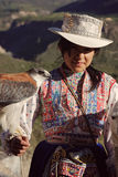 Woman with a tame hawk and a llama in Colca Canyon Stock Image