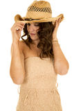 Woman tan strapless dress western hat look down Royalty Free Stock Image