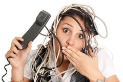 Woman tangled in cables Stock Photo