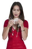 Woman with tangled headphones Royalty Free Stock Photos