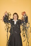 Woman with tangled wires. Stock Photo