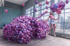 Woman with tank of balloons portrait  photoshoot