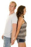 Woman in tank man blue shirt backs together him look Stock Photo