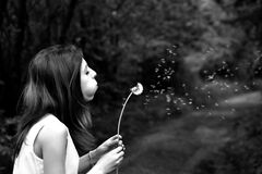Woman in Tank Top Blowing Dandelion in Grayscale Photography Royalty Free Stock Photos