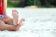 A Woman tanned legs on sand beach. Travel concept. royalty free stock photography