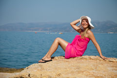 Woman tanning on exotic beach Royalty Free Stock Photography