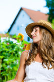Woman tanning in her garden on lounge chair Royalty Free Stock Photography