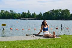 Woman tanning on the lake Royalty Free Stock Image