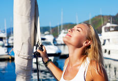 Woman tanning on luxury yacht Royalty Free Stock Image