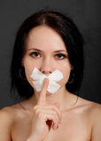Woman with tape. Over her mouth Royalty Free Stock Photography