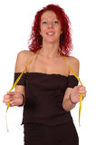 Woman with tape measure. Woman holding yellow tape measure, isolated on white background stock images